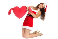 Santa woman holding  heart shape Royalty Free Stock Images