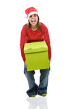 Santa woman holding heavy present box Stock Images