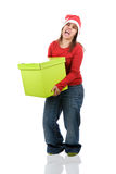 Santa woman holding heavy present box Stock Image