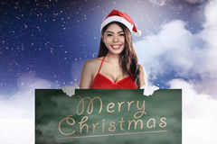 Santa Woman Holding Merry Christmas Board Royalty Free Stock Photography