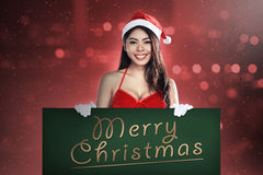 Santa Woman Holding Merry Christmas Board Royalty Free Stock Photo