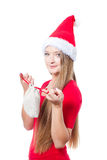 Santa woman holding a present Royalty Free Stock Photos
