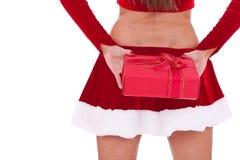 Santa woman holding a present box at back Stock Images