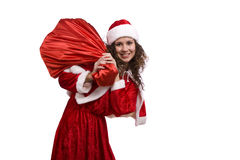 Santa woman is holding red sack with gifts. royalty free stock image
