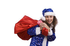 Santa woman is holding red sack with gifts. Stock Photos