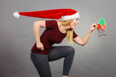 Santa woman holding shopping cart with christmas gifts Stock Photography