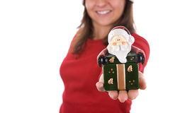 Santa woman holding small box in the hand. Santa woman holding small christmas box in the hand isolated on white background Royalty Free Stock Photo