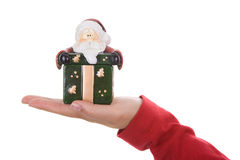 Santa woman holding small christmas present box. In the hand isolated on white background Stock Photos