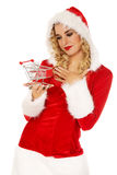 Santa woman holding a small trolley Royalty Free Stock Photography