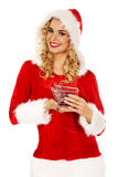 Santa woman holding a small trolley Stock Photo