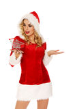 Santa woman holding a small trolley Stock Photos