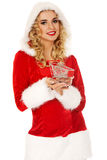 Santa woman holding a small trolley Royalty Free Stock Image