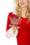 Santa woman holding a small trolley Royalty Free Stock Photos