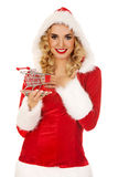Santa woman holding a small trolley Stock Images