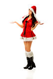 Santa woman holding something in both hands Stock Images