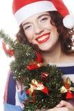 Santa woman holding tree Royalty Free Stock Photo