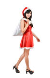 Santa woman  holding a white bag Royalty Free Stock Photography