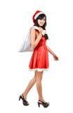 Santa woman  holding a white bag Royalty Free Stock Photography