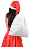 Santa woman  holding a white bag Stock Photo