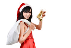 Santa woman  holding a white bag Royalty Free Stock Image