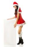 Santa woman holding white empty banner.  Stock Photography