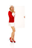 Santa woman holding white empty banner Stock Photo