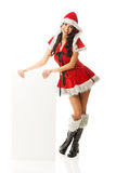 Santa woman holding white empty banner Royalty Free Stock Images