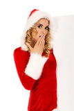 Santa woman holding white empty banner Royalty Free Stock Image