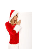 Santa woman holding white empty banner Royalty Free Stock Photography