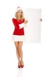 Santa woman holding white empty banner.  Stock Photo