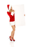 Santa woman holding white empty banner Stock Images