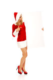 Santa woman holding white empty banner.  Royalty Free Stock Image