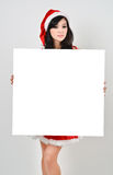 Santa woman  holding a white poster Royalty Free Stock Images