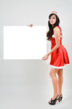 Santa woman  holding a white poster Stock Images