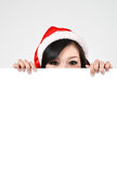 Santa woman  holding a white poster Stock Image