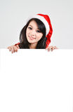 Santa woman  holding a white poster Stock Photography
