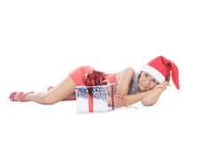Santa woman lie with gift box Royalty Free Stock Photography