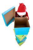 Santa woman looking at empty christmas present box Stock Photography