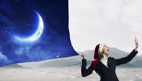 Santa woman with mobile phone Royalty Free Stock Photos