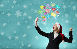 Santa woman with mobile phone Stock Photography