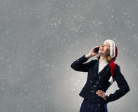 Santa woman with mobile phone Stock Images