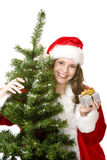 Santa Woman Near Fir Tree Holds Christmas Gift Stock Photos