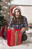 Santa woman opening magical Christmas present box Royalty Free Stock Image
