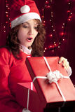 Santa Woman Opening a Present Stock Photos