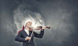 Santa woman play violin Stock Images