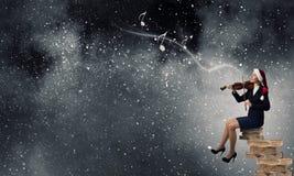Santa woman play violin Royalty Free Stock Images
