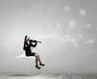 Santa woman play violin Stock Photography