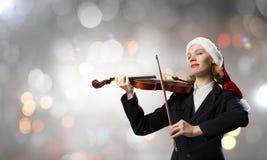 Santa woman play violin Royalty Free Stock Photos