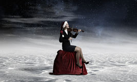 Santa woman play violin Stock Image