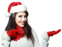Santa woman pointing. Beautiful smiling christmas santa woman pointing up showing copyspace. Isolated on white background Royalty Free Stock Images